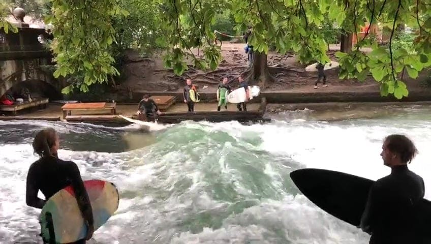 People Surfboarding In The River