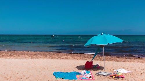 Blue Beach Umbrella On The Seashore