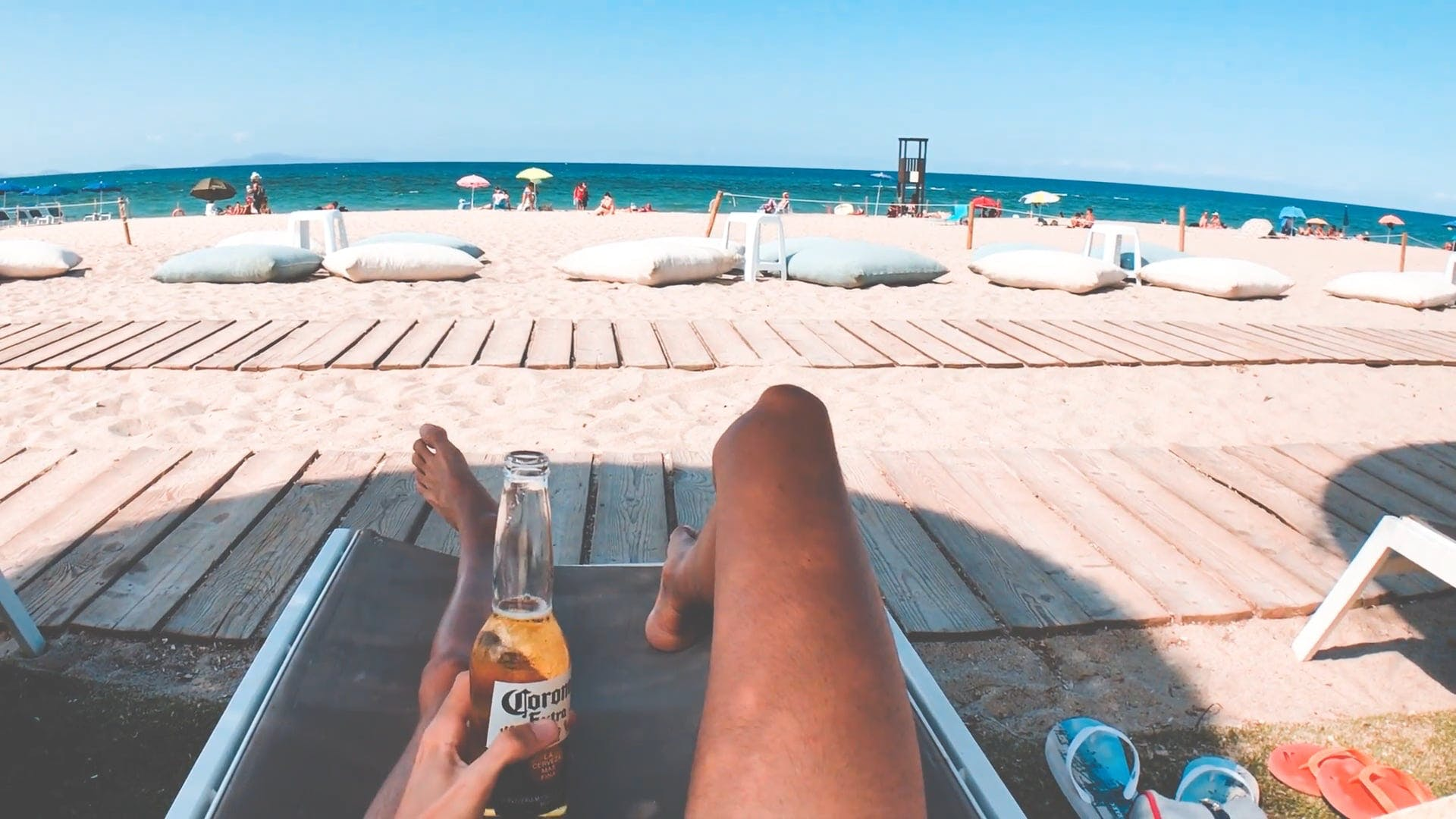 Man Relaxing And Drinking By The Beach