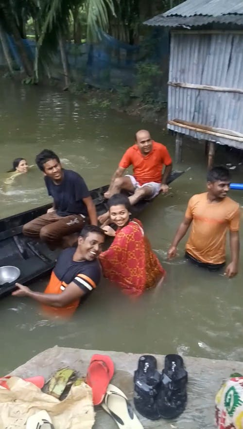 People On Flooded Area