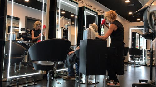 Man Having Haircut At A Salon