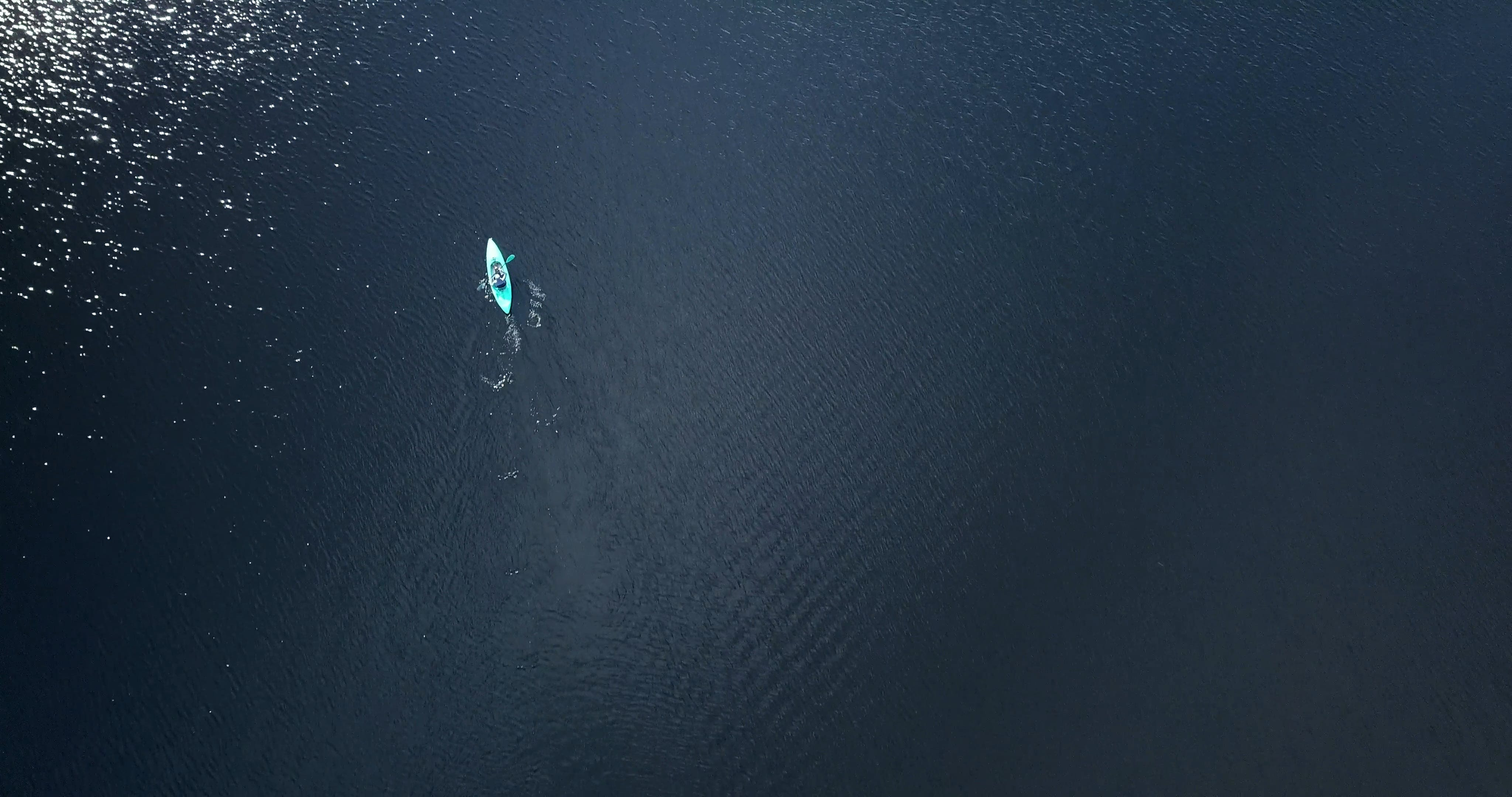 Kayaking In The Middle Of A Big Body Of Water