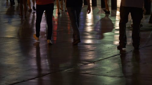 Groups of People Walking At Night