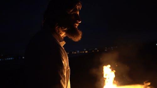 Man Doing Rituals Infront Of A Bonfire