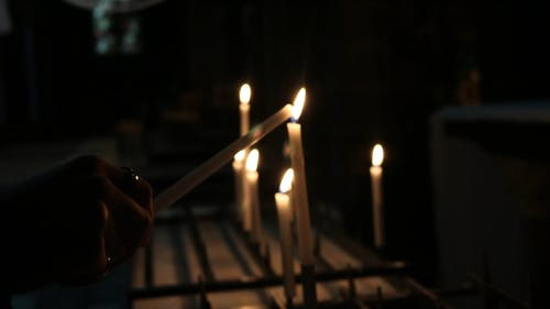 Person Lighting Up A Candle