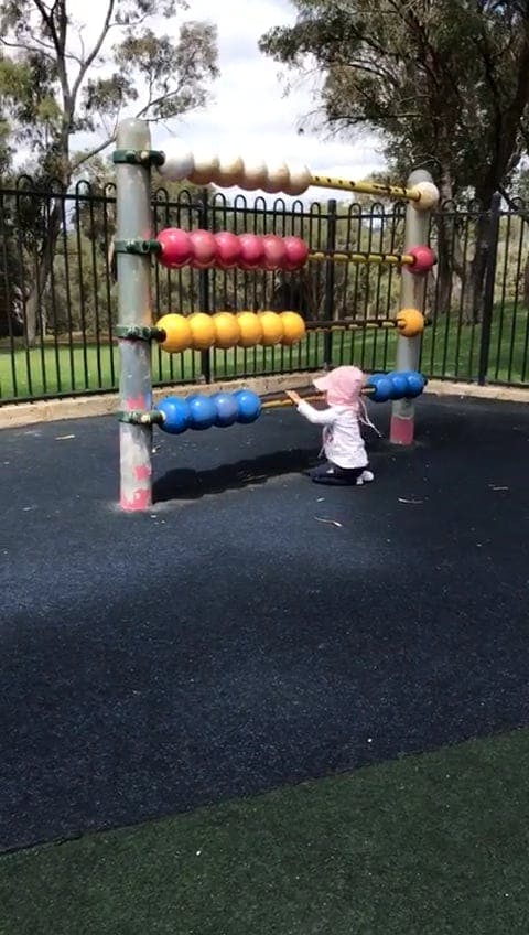 Baby Girl Playing In The Park