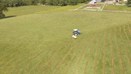 Cleaning The Field Using A Tractor