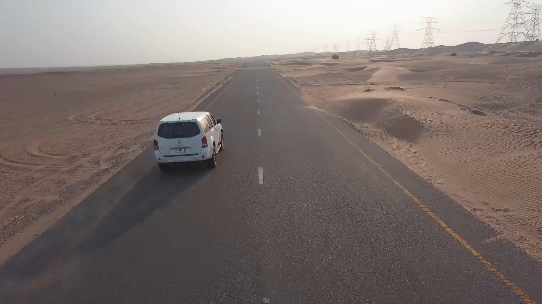 Vehicle Traveling Between Desert Lands