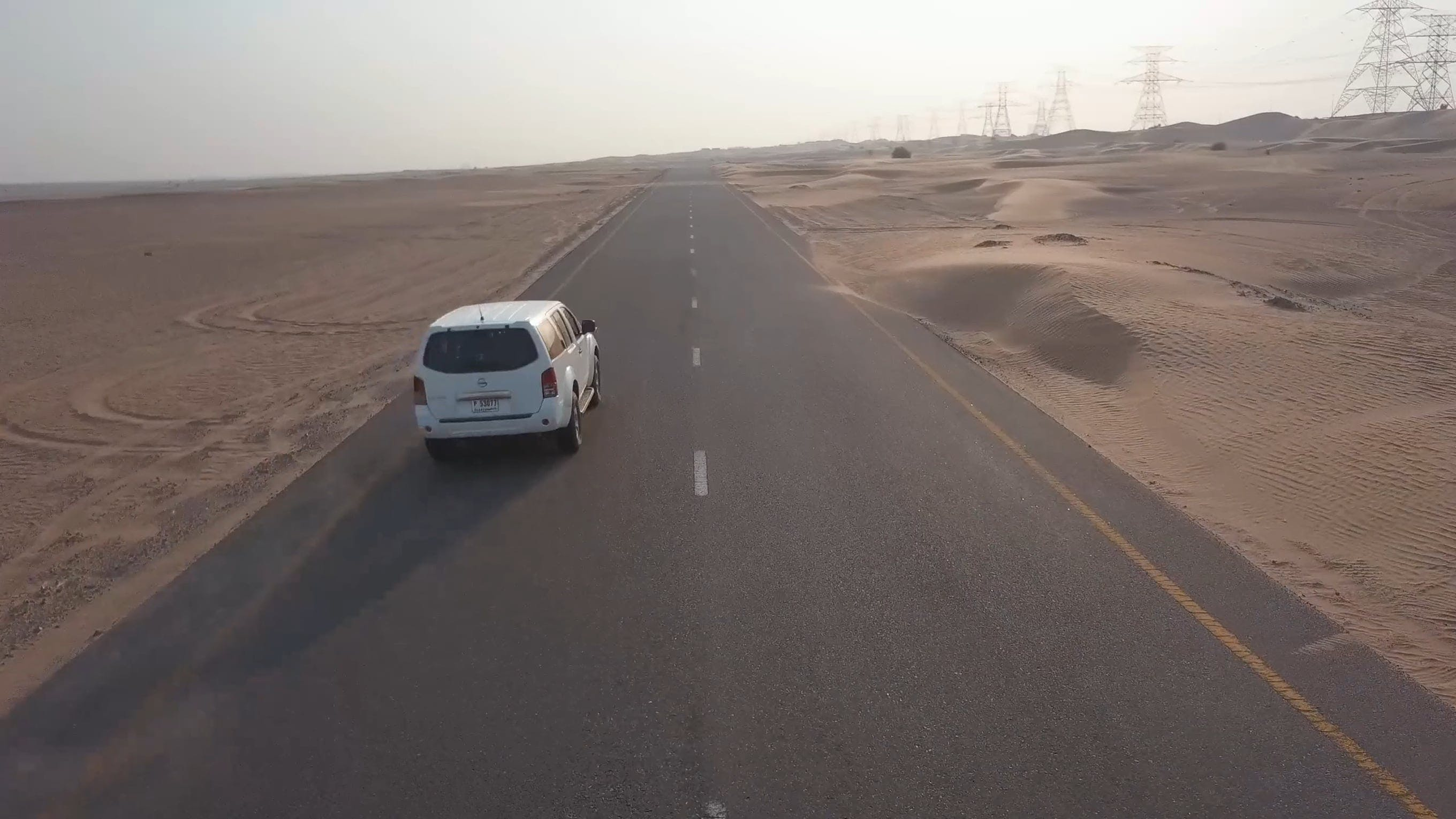 Car Driving Along The Dessert Highway
