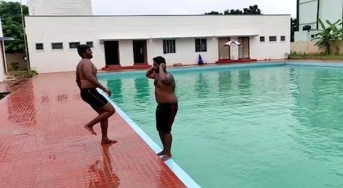 Boy Making A Big Splash On Pool