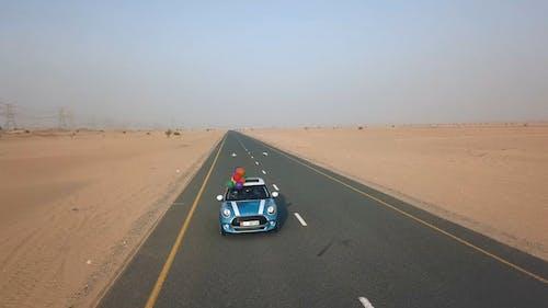 Mini Cooper On Highway Along The Desert