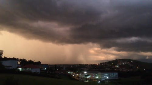 Dark Clouds With Rain Over The City