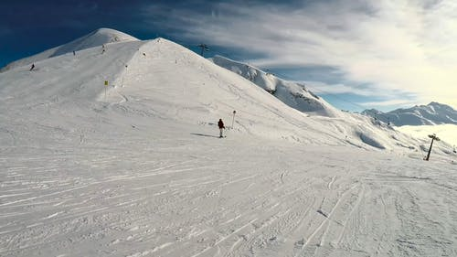 People Snowboarding At A Resort