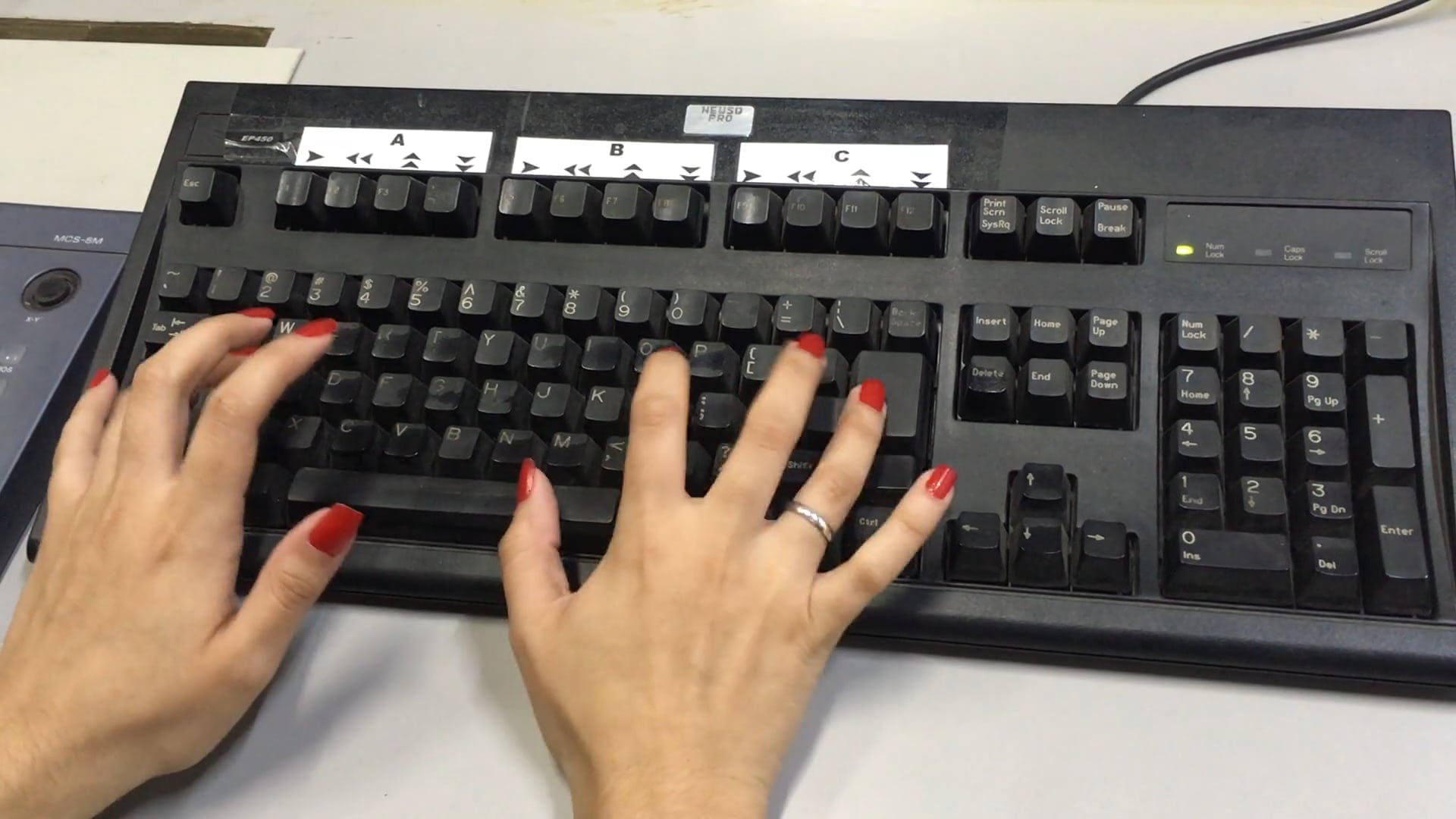Person Using A Keyboard