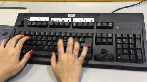 Hands In A Computer Keyboard