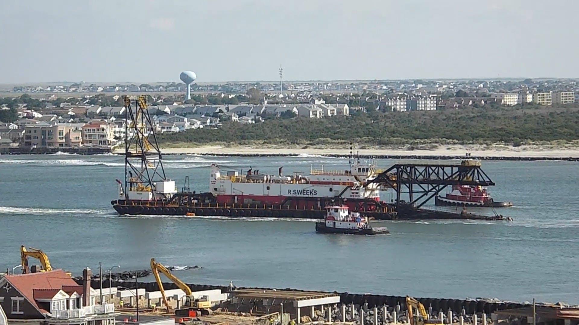 Cargo Ship Sailing Across The River