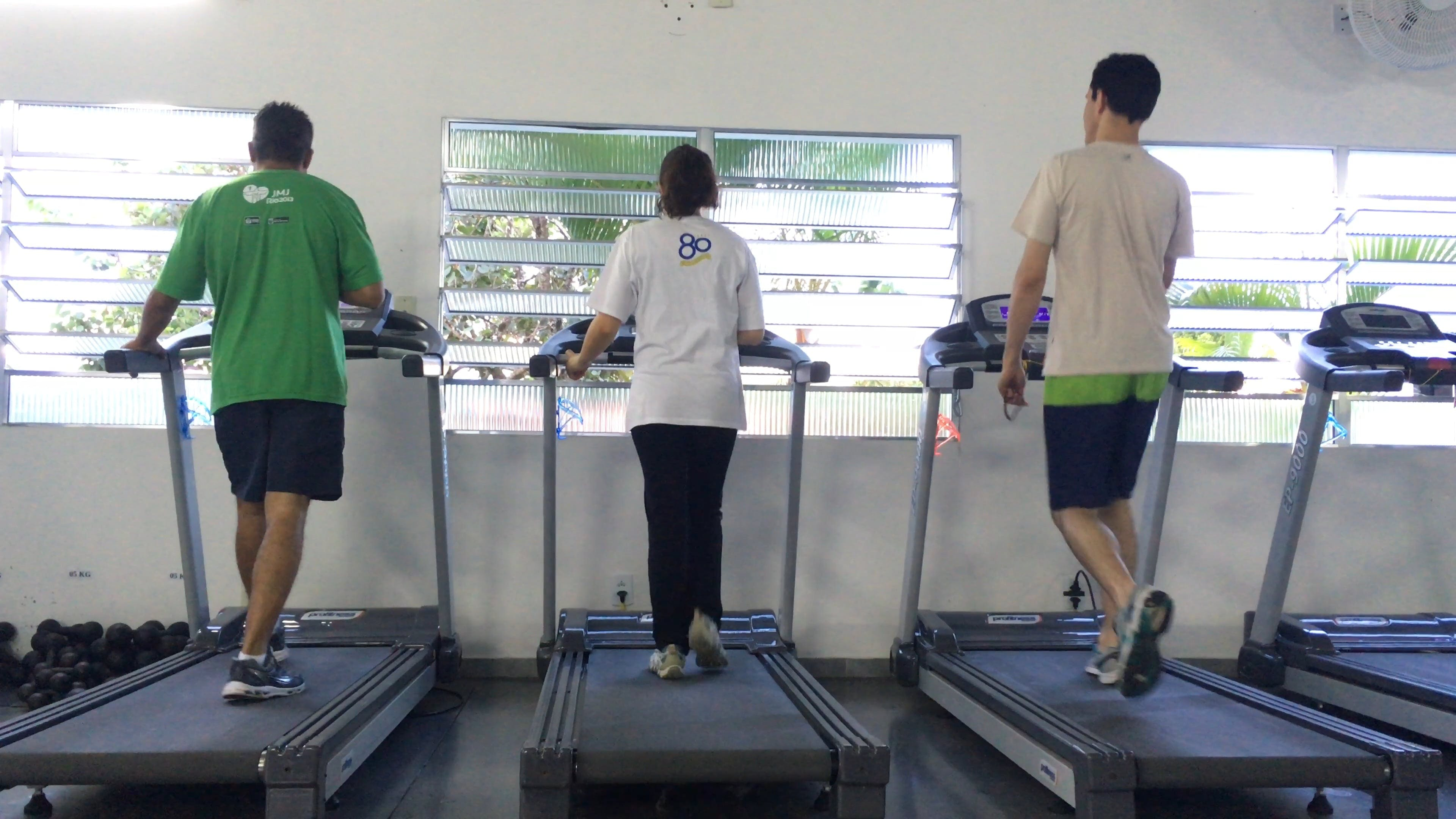 People Doing Exercises On A TreadMill