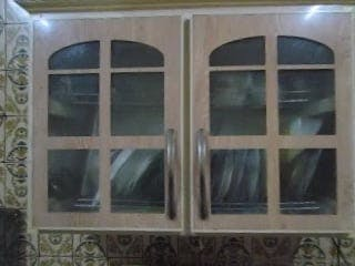 Cupboard With Plates Inside