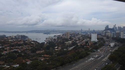 City Below Clouds In Timelapse Mode