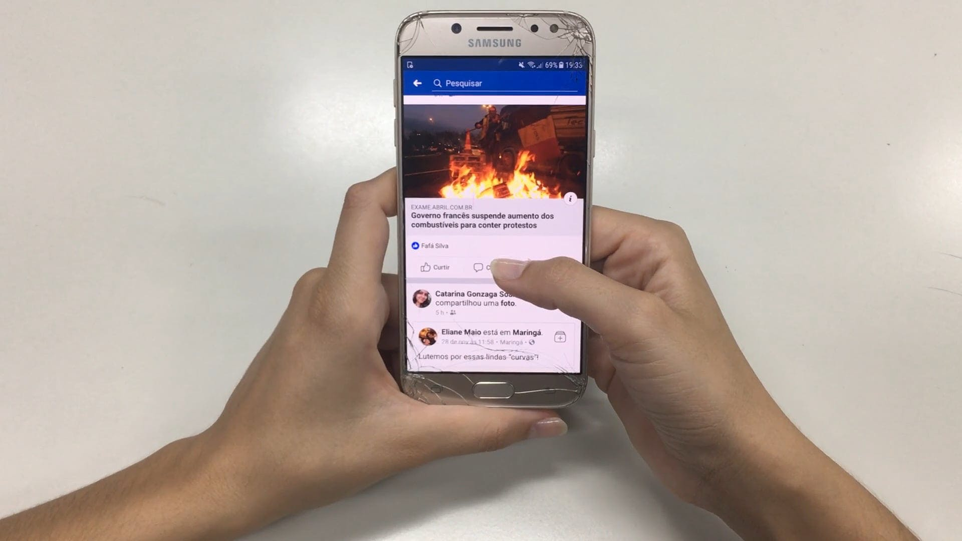 Person Scrolling A Samsung Smartphone