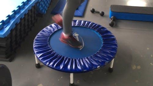 Person Exercising Using A Mini Trampoline