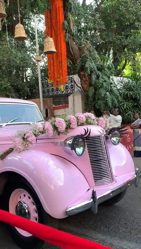 Pink Vintage Car In A Parade