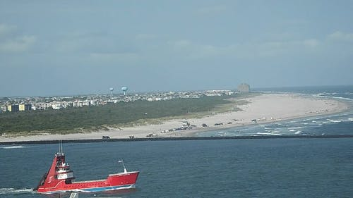 Ship and Boat Sailing Across The Sea