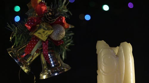 Christmas Decor And A Burning Candle