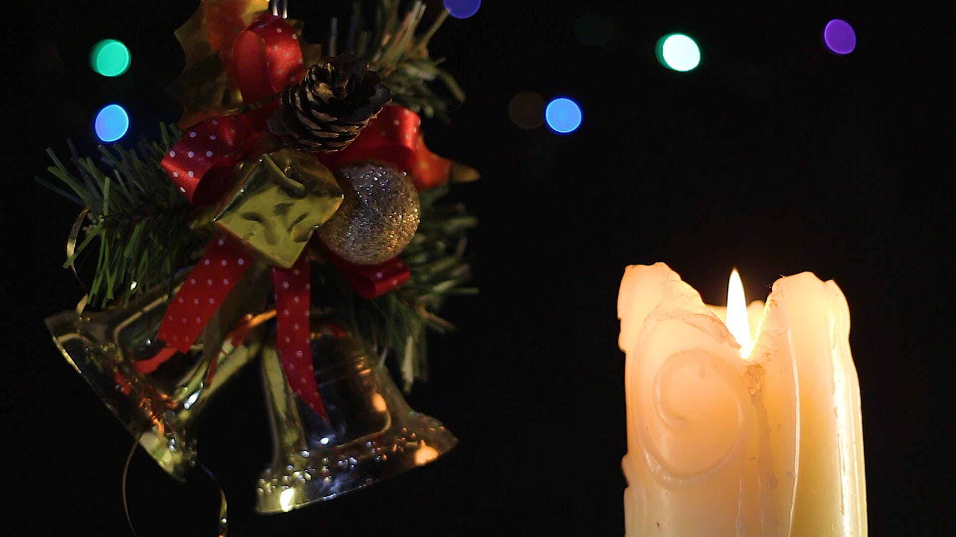 Christmas Ornaments And A Lighted Candle