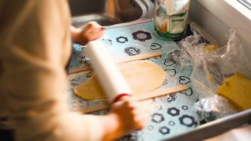 Woman Preparing Dough To Bake