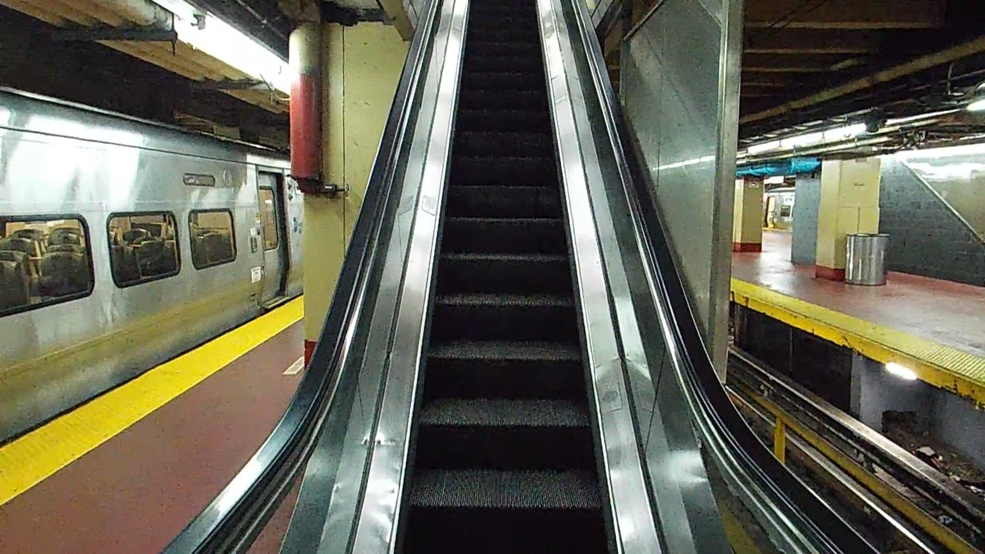 An Escalator On A Train Station