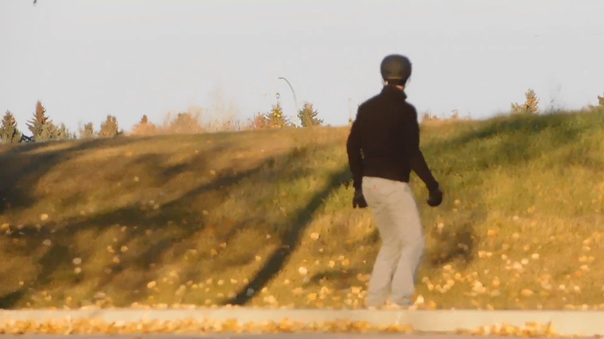 An Individual Using A Skateboard