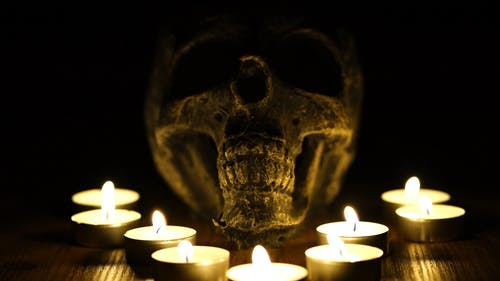 A Skull With Lighted Tea Candles