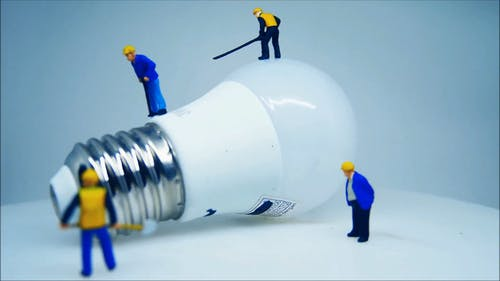 Close-up View Of A Lightbulb And Miniature Toys