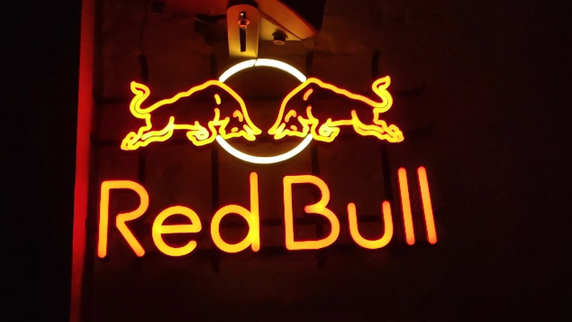 Glowing Sign Board Of Red Bull