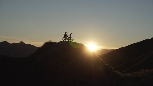 Silhouette Of People On A Bike