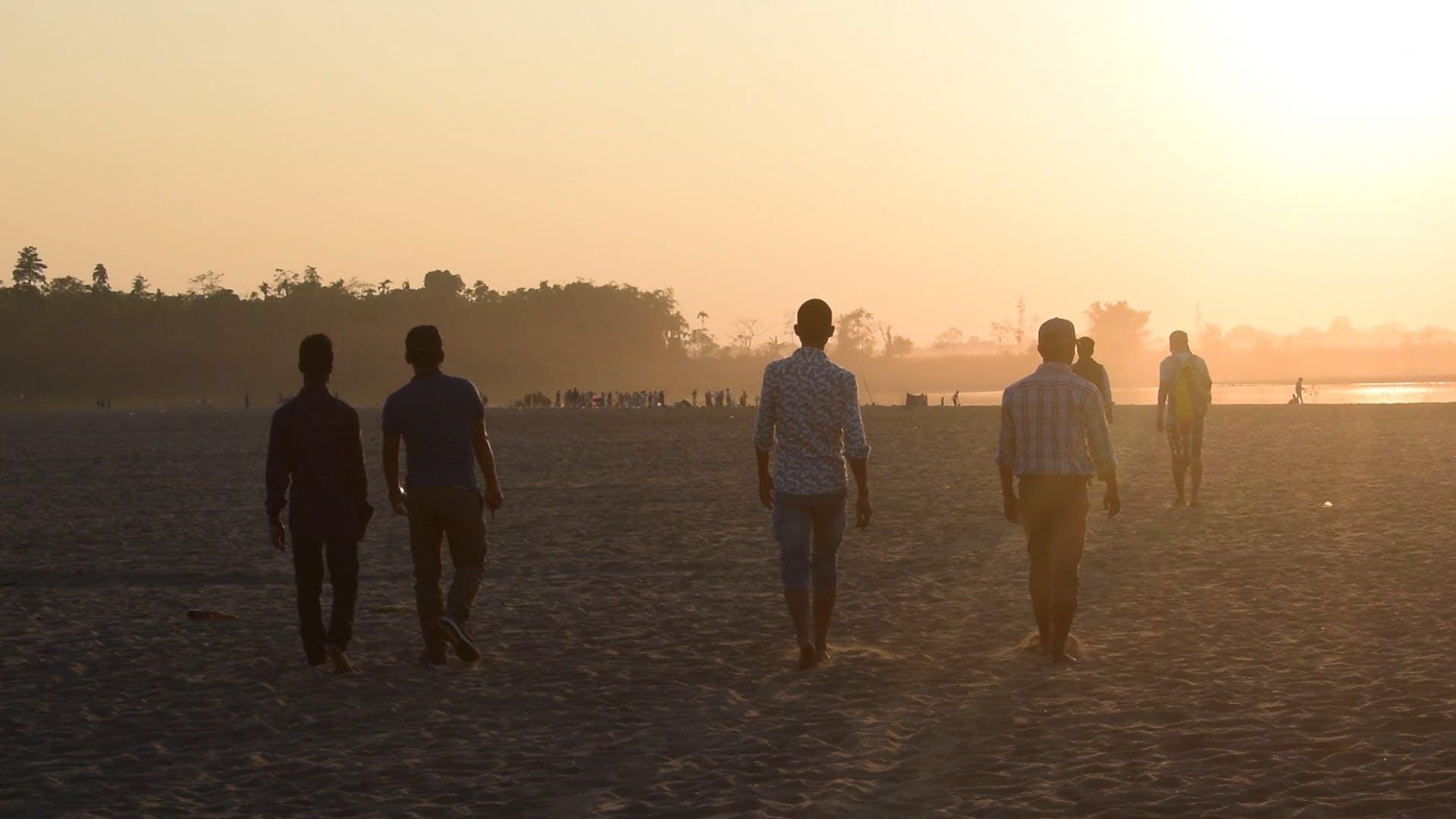 Boys Walking On The Beach
