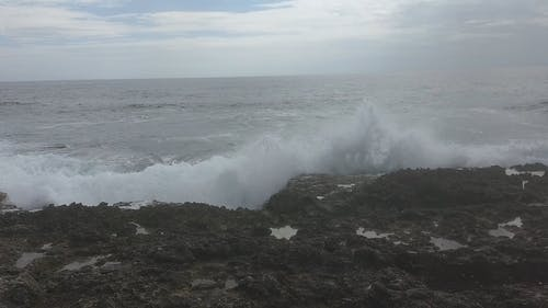 Waves Breaking To The Rocks