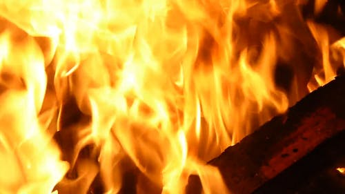 Close-Up View Of Burning Firewoods