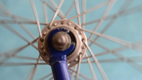 Close-Up View Of A Bicycle's Spokes And Hub