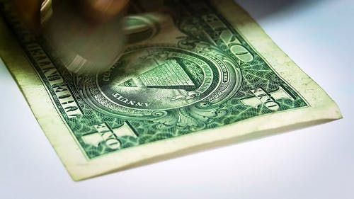 Close-Up View Of One Dollar Bill And Coins