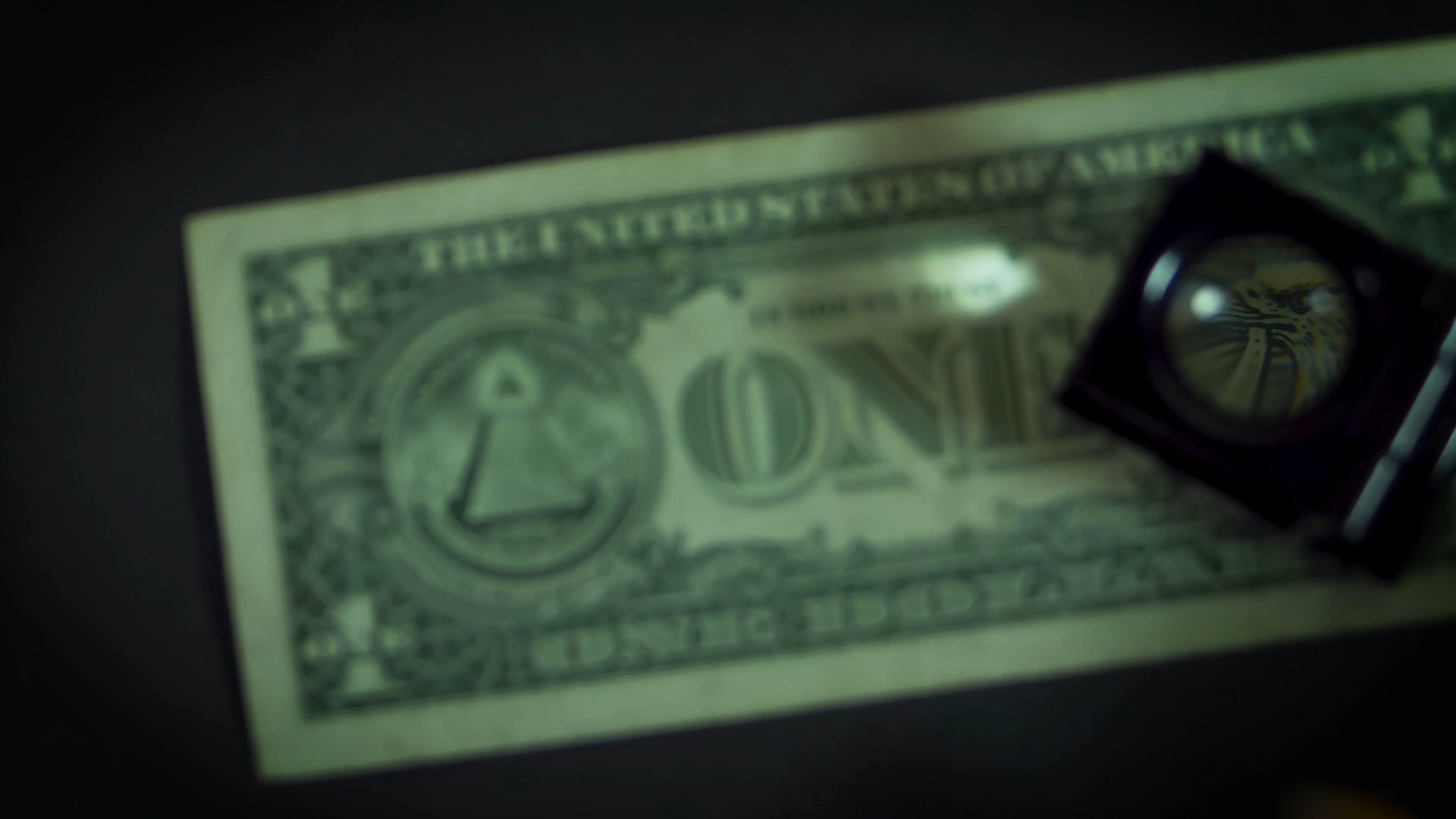 Magnifying Glass Over A Dollar Bill
