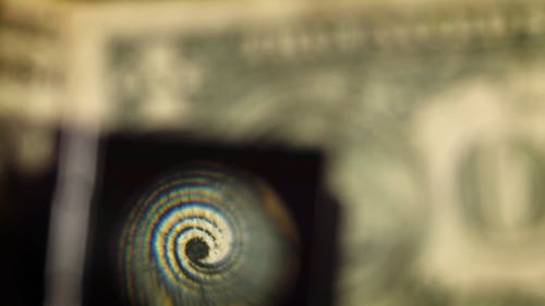 a Dollar Bill Being Magnified