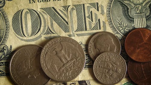 A Dollar Bill and Variety of Coins