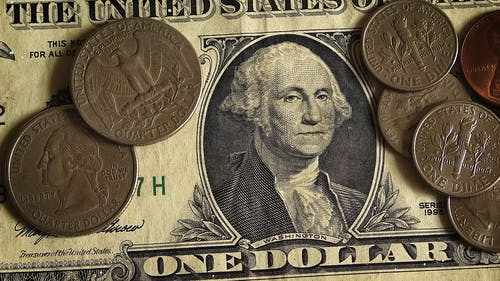 Close-up View Of A Dollar And Coins