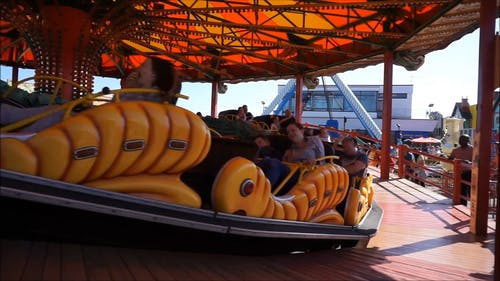 People Enjoying A Caterpillar Ride