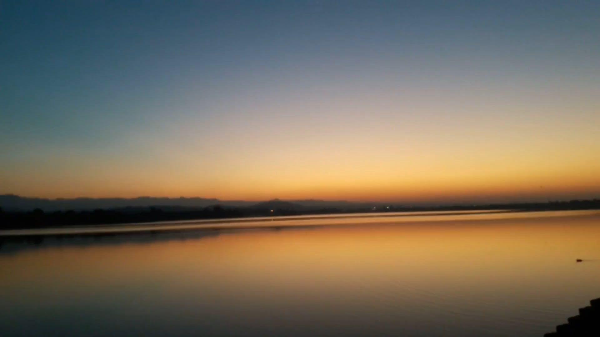 View Of A Lake At Sunset