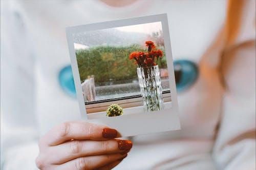 Woman Holding Polaroid