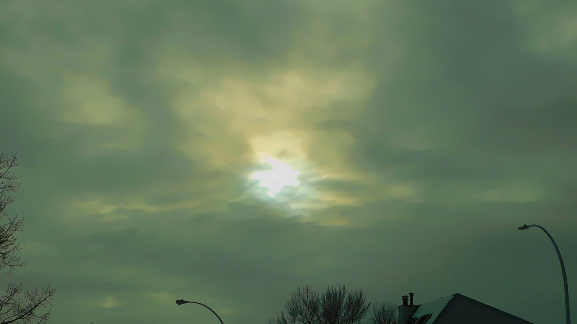 Sun Surfacing Through Clouds