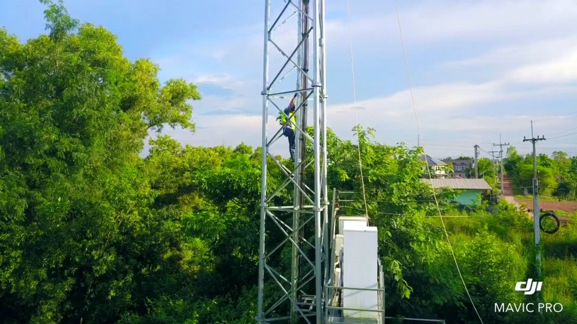 Man Working On A Tower